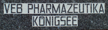 "A granite plaque at the first store with the words ""VEB pharmaceuticals Königsee"", the name of the company after the forced nationalization in East Germany in the 1970s."